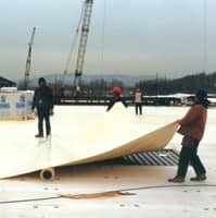 Installation of a Custom Roll of FiberTite Roofing Membrane