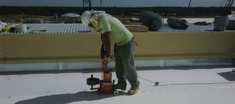 Contractor Working on a FiberTite Roofing System